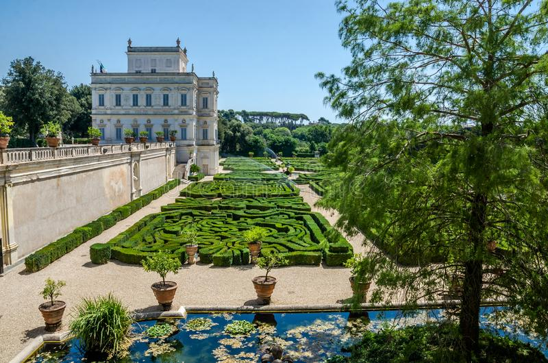 The palace with a garden labyrinth in the Villa Doria-Pamphili in Rome, Italy stock photo