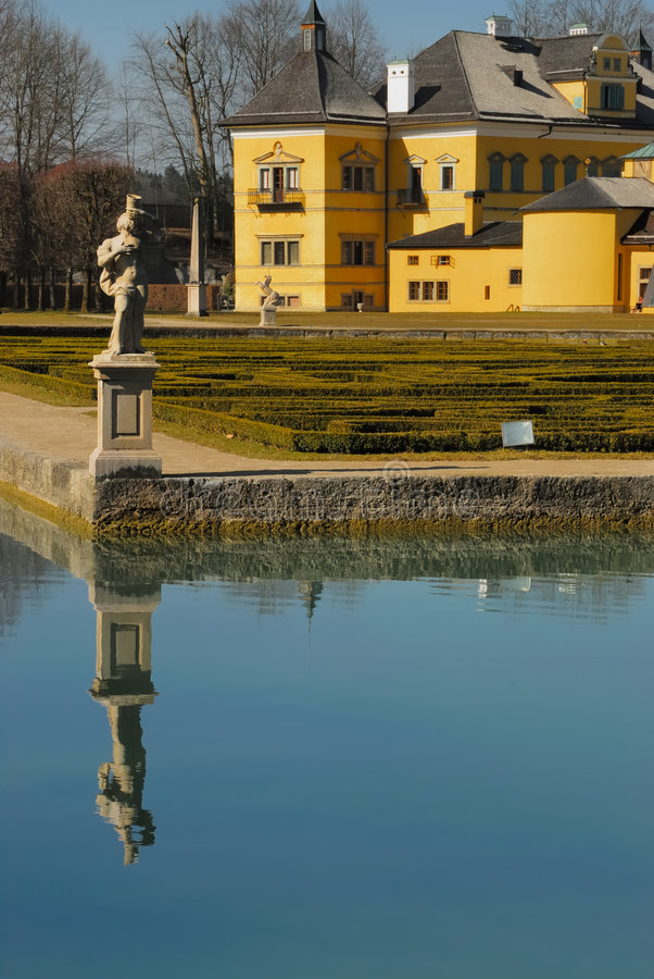 Palace Hellbrunn with pond no.1. Palace Hellbrunn and reflection of a statue in a pond royalty free stock photos