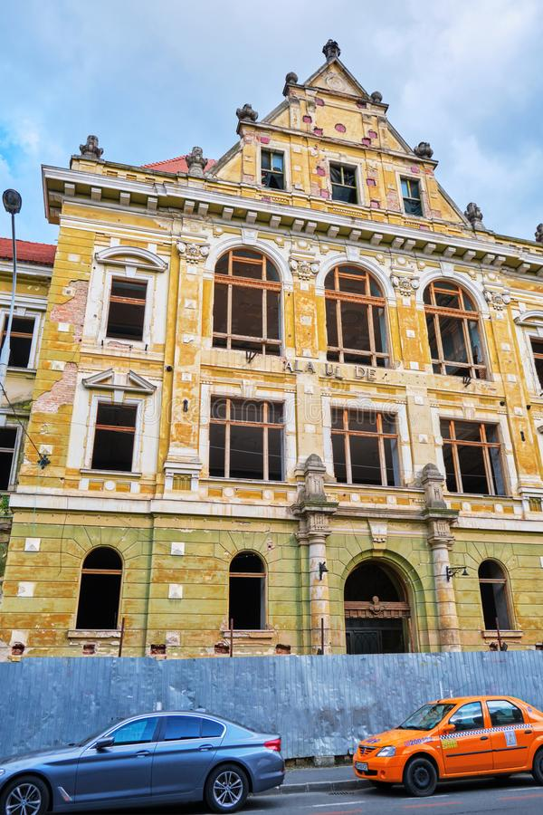 Palace of Justice Palatul de Justitie abandoned historical building near city center - vertical. Sibiu, Romania - July 11, 2019: Palace of Justice Palatul de stock image