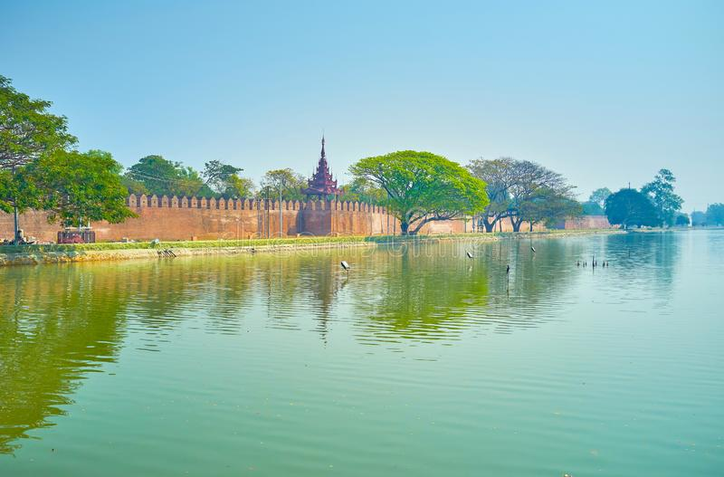 The palace moat in Mandalay, Myanmar. The wide doug moat that surrounds the Royal Palace in Mandalay, Myanmar stock photography