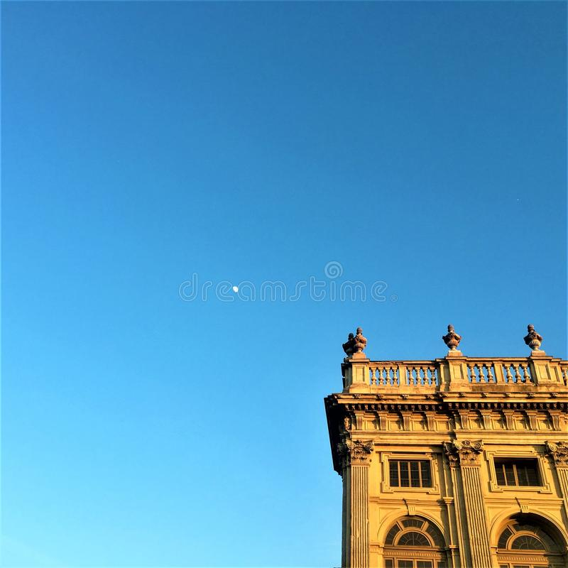 Palace, moon, fairytale and sky in Turin city, Italy royalty free stock image