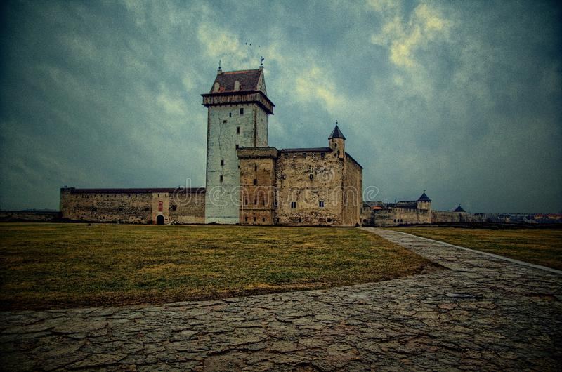Palace in Narva, Estonia. Deep and rapid River Narva, directly on the border with Russia, stands the powerful Hermann Fortress, which is the best-preserved royalty free stock photos
