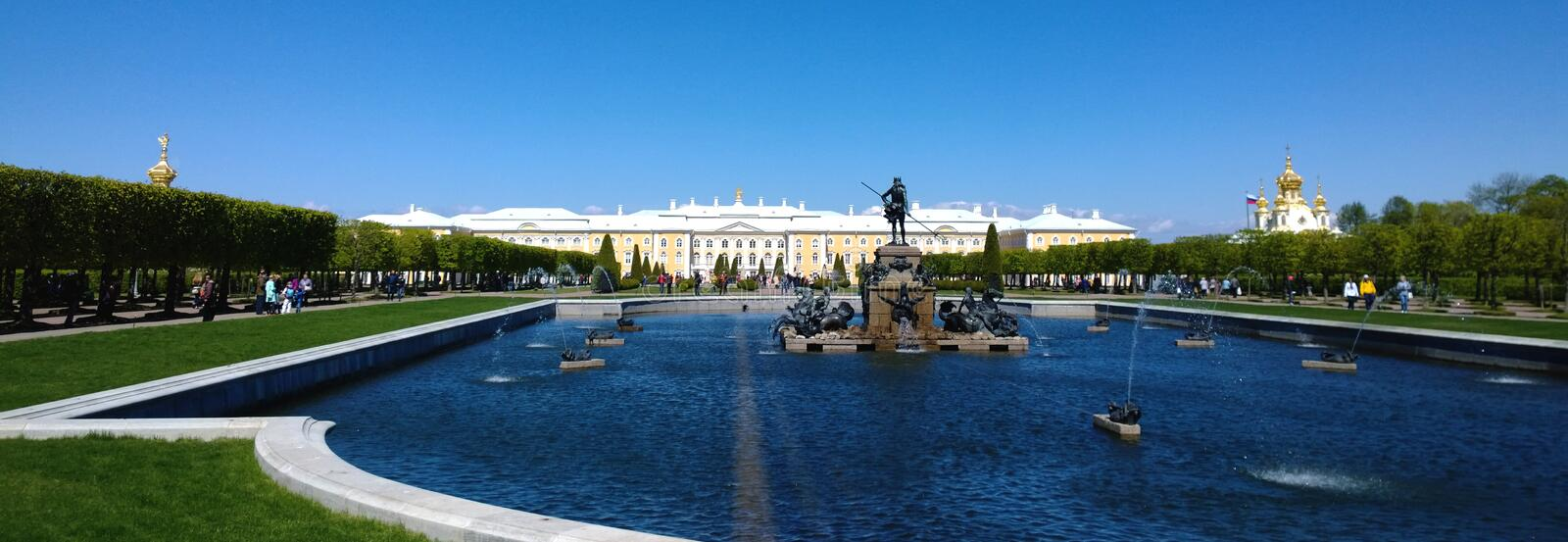 Palace in Peterhof. The view from the Upper Park. In the foreground a pond with small fountains. Summer, Sunny day stock image