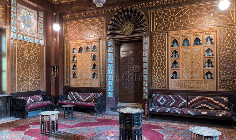 Palace of Prince Mohammed Ali. Guests Hall with wooden ornate ceiling, wooden ornate door, lanterns, colorful ornate couches royalty free stock image