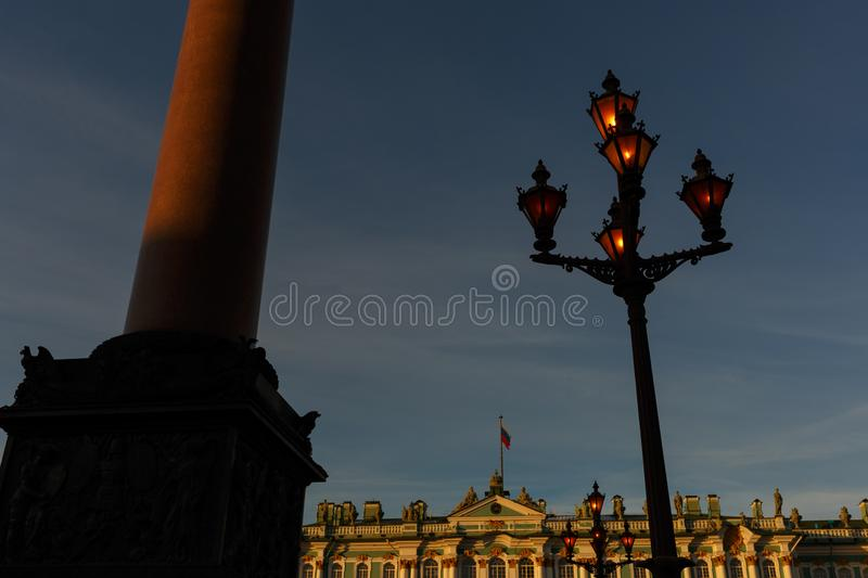 Palace square. Facade of the Winter Palace, house of the Hermitage Museum, Alexander Column and working flashlight in St. Petersbu stock photo