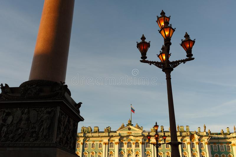 Palace square. Facade of the Winter Palace, house of the Hermitage Museum, Alexander Column and working flashlight in St. Petersbu royalty free stock photos
