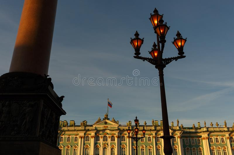 Palace square. Facade of the Winter Palace, house of the Hermitage Museum, Alexander Column and working flashlight in St. Petersbu stock photos