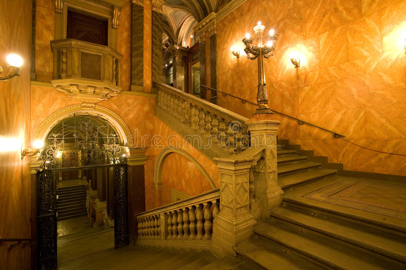 Palace staircase. Elegant palace staircase with lights royalty free stock image