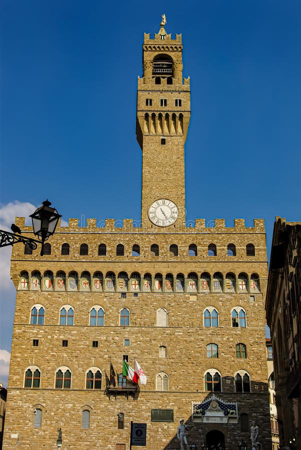 Palace Vecchio at Signoria square illuminated during sunset in Florence, Italy royalty free stock photos