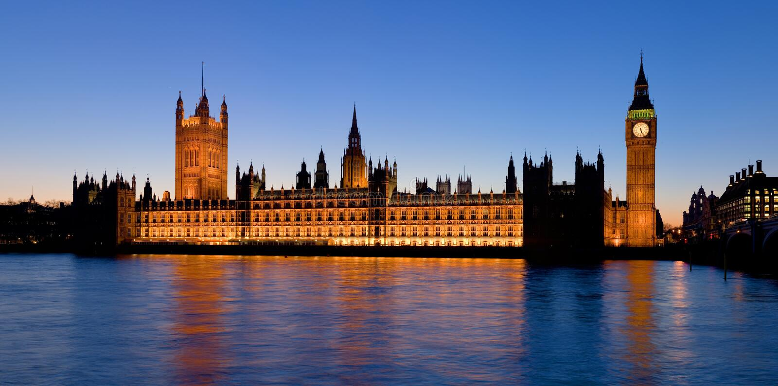The Palace of Westminster at dusk. A high resolution panoramic view of the Palace of Westminster from the South Bank of the Thames in London, England stock image