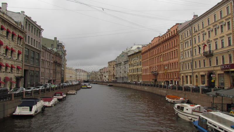 Palaces on the river with boats in Saint-Petersburg stock photos