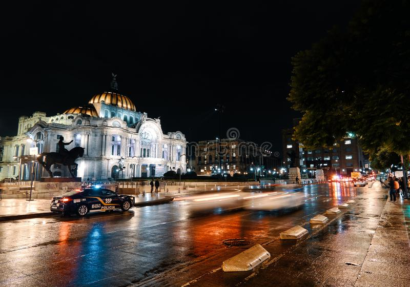 Palacio de Bellas Artes of Mexico City at night. Distrito Federal, Mexico City, July 25, 2019 - Palacio de Bellas Artes with traffic in historic center of Mexico stock photo