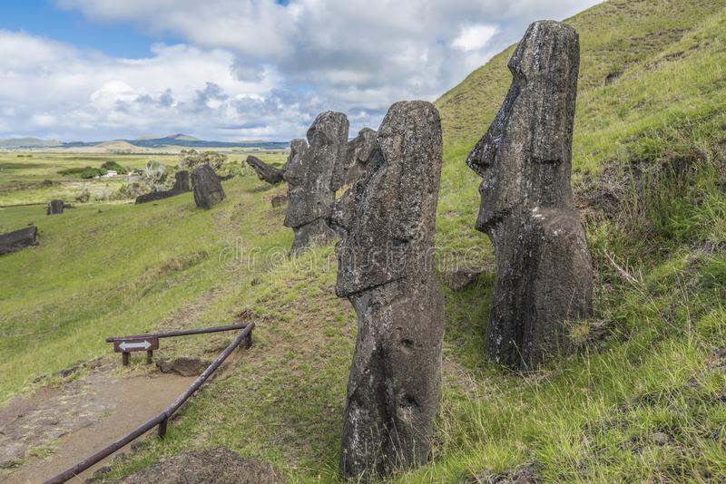 Paladins of a disappeared civilization. Path on the hill of the moais of the Rano Raraku volcano where all the moai were sculpted stock photography