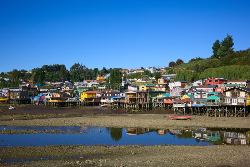 Palafito Wooden Stilt Houses in Castro, Chiloe Archipelago, Chile. Colorful Palafitos, traditional wooden stilt houses at low tide in Castro, the capital of the stock photos