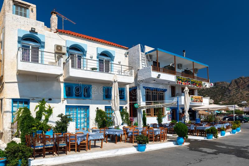 Traditional white greek architecture with white walls and blue windows. royalty free stock image