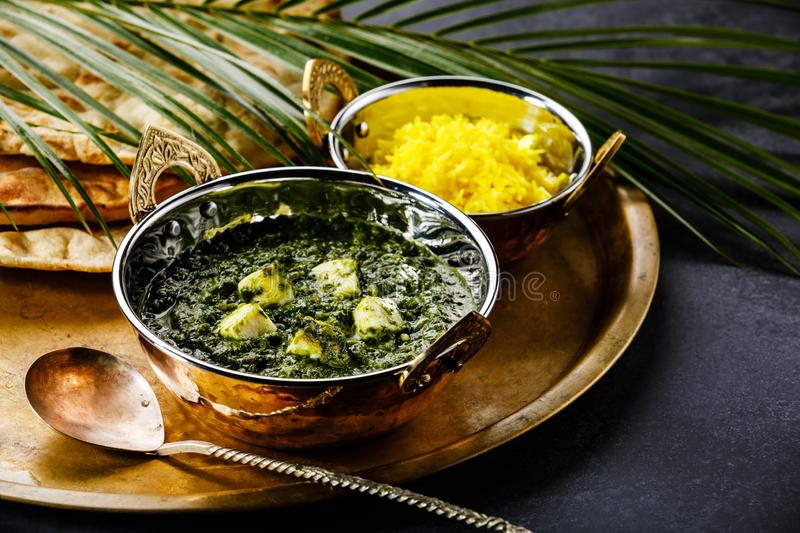Palak Paneer indian food with cheese and spinach, Naan bread and Basmati Rice with Saffron royalty free stock images