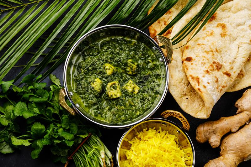 Palak Paneer indian food with cheese and spinach, Naan bread and Basmati Rice with Saffron stock images
