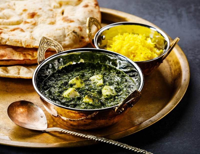 Palak Paneer indian food with cheese and spinach, Naan bread and Basmati Rice with Saffron stock photos