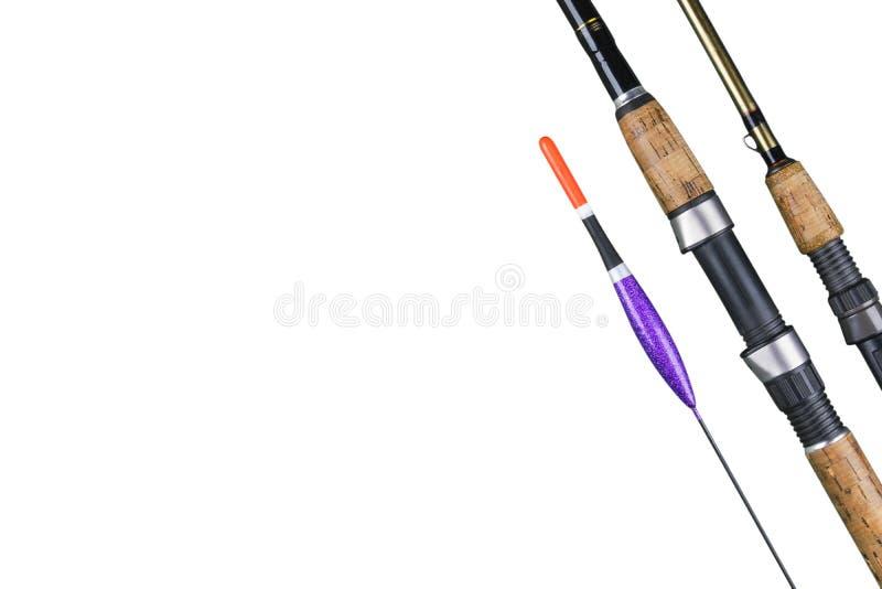 Palan de pêche Canne à pêche pêchant le flotteur et tournant des attraits d'isolement sur le fond blanc Concept de pêche photographie stock