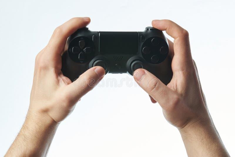 Palanca de mando negra en manos imagen de archivo libre de regalías