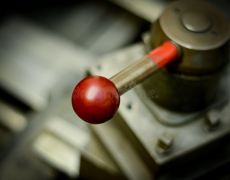 Palanca roja de la maquinaria imagenes de archivo