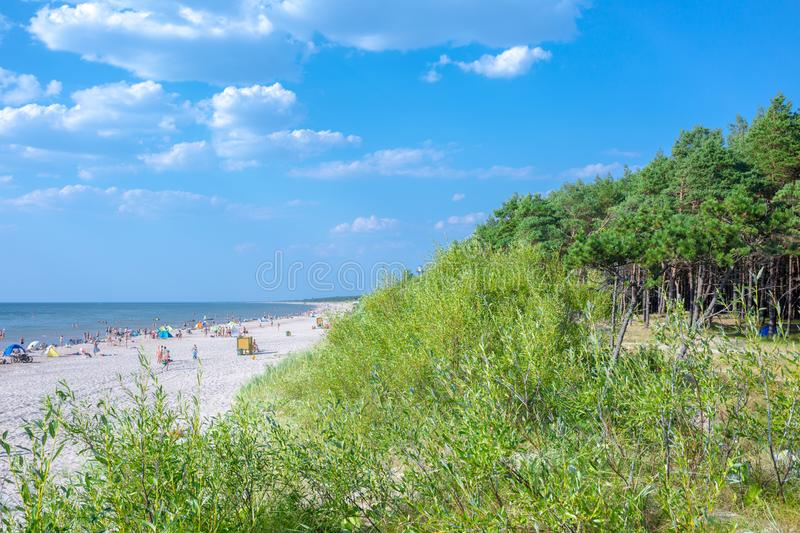 Palanga, Lithuania - Aug 03: People are relaxing on sandy beach of the Baltic sea. Seaside resort at warm summer day on Baltic sea stock photos