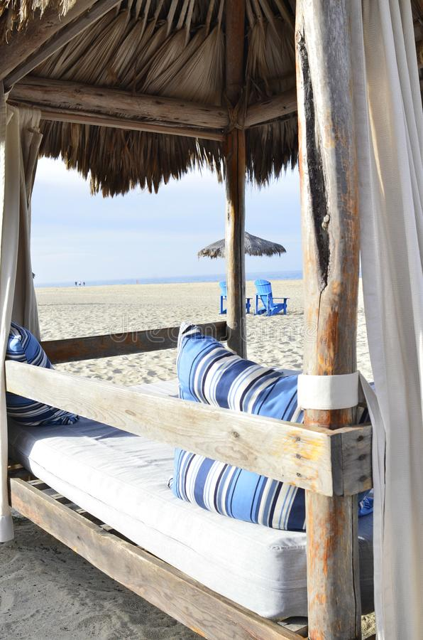 Palapa beach bed luxury seashore relaxation Baja,Mexico royalty free stock photo