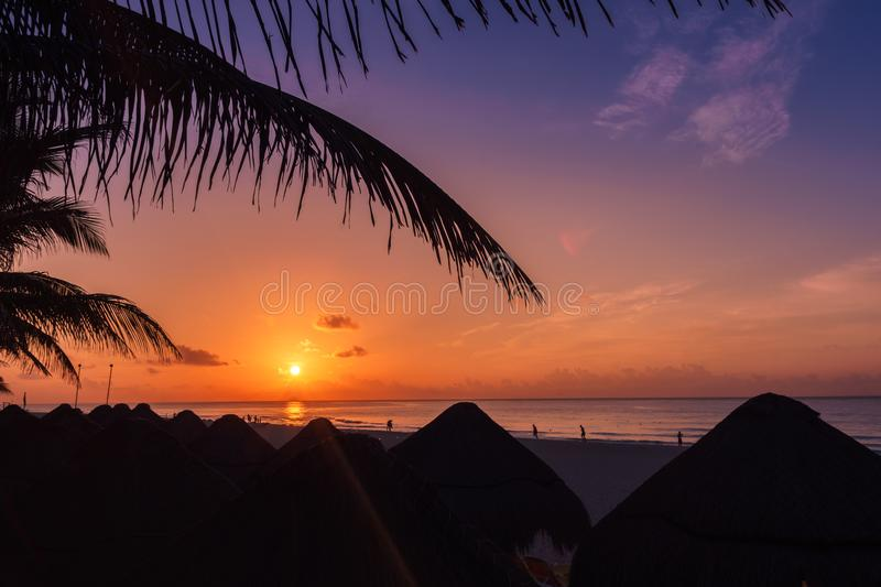 A palapa hut on the beach at sunset in Playa del Carmen Mexico royalty free stock images