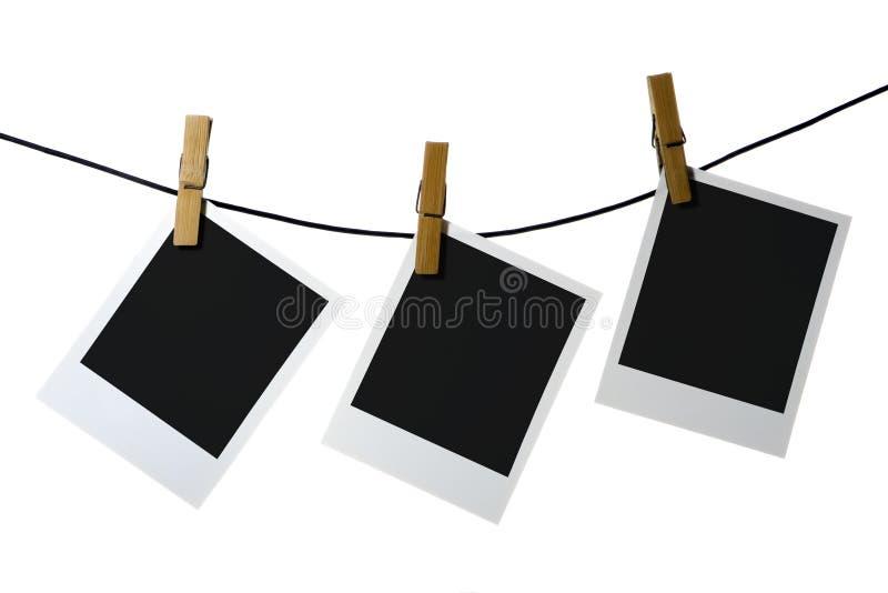 Palaroid blank clothes-peg rope stock photography