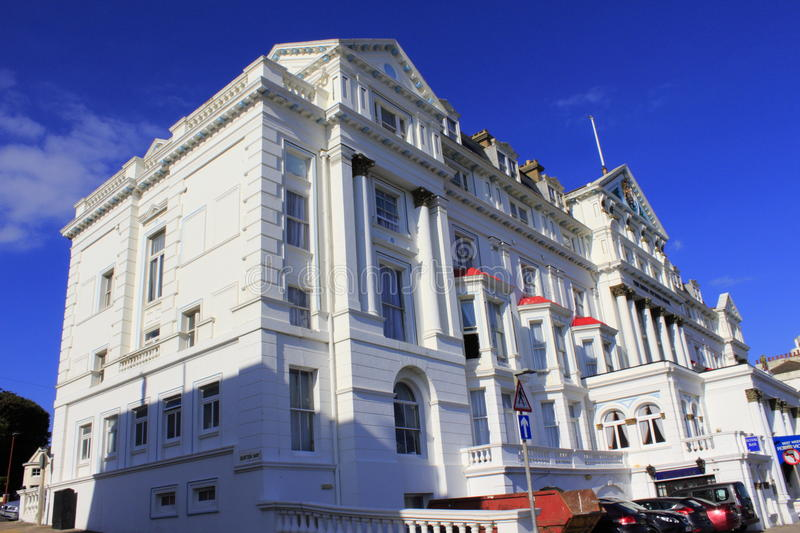 Palatial building Hastings United Kingdom. Beautiful white palatial hotel building along A 259 motorway in Hastings.Hastings is a town on England's stock images