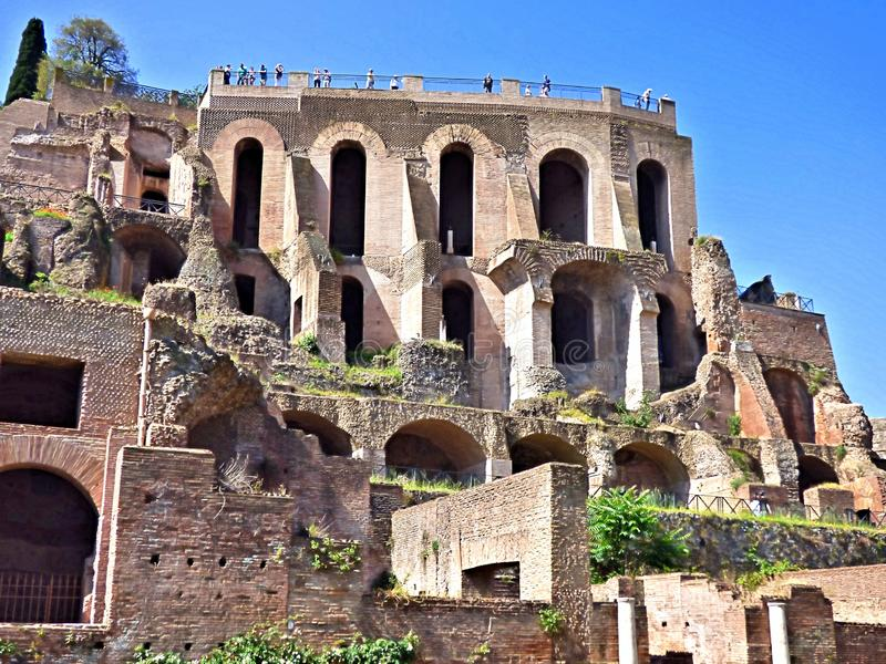 Palatine hill in Rome Italy. Looking up at Palatine Hill from the Roman Forum in Rome Italy. Blue sky background stock image