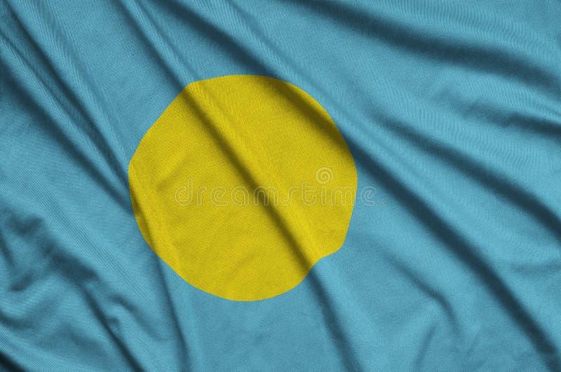Palau embandeira é descrito em uma tela de pano dos esportes com muitas dobras Bandeira da equipe de esporte fotografia de stock