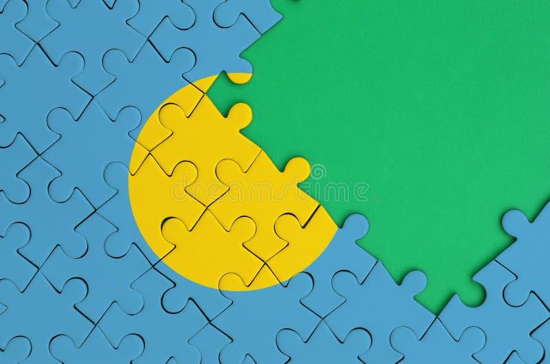 Palau señala por medio de una bandera se representa en un rompecabezas terminado con el espacio verde libre de la copia en el lad fotografía de archivo libre de regalías