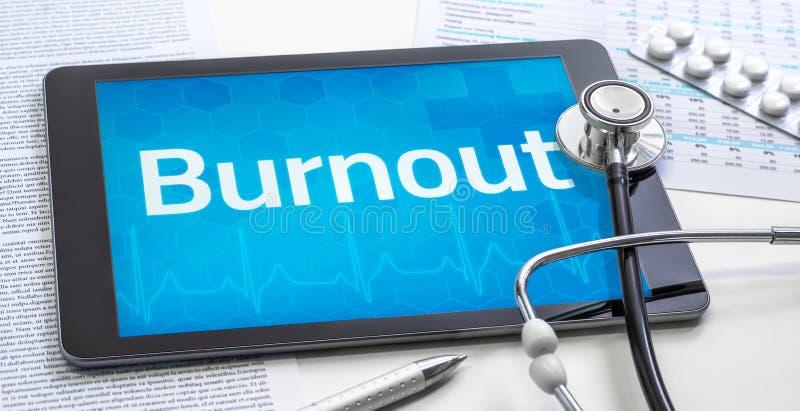 A palavra Burnout na apresentação de um comprimido fotos de stock royalty free