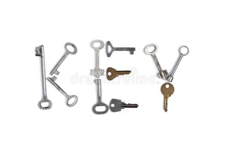 Palavra chave feita de chaves velhas no fundo isolado branco Conceptual fotografia de stock