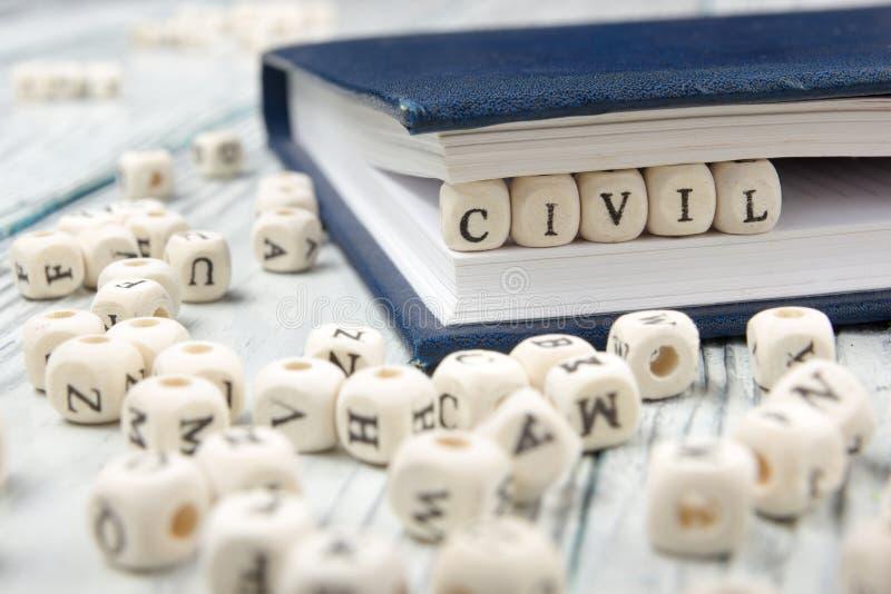 Palavra CIVIL escrita no bloco de madeira ABC de madeira fotografia de stock royalty free