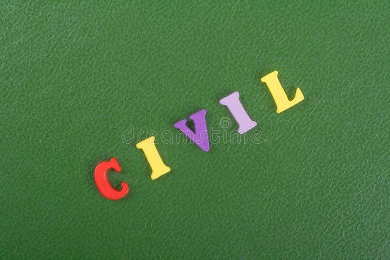 Palavra CIVIL no fundo verde composto das letras de madeira do bloco colorido do alfabeto do ABC, espaço da cópia para o texto do imagem de stock