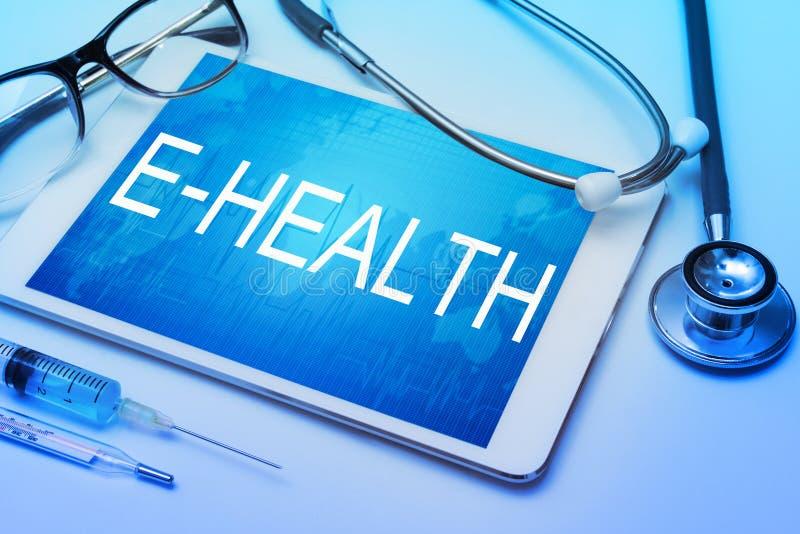 Palavra da E-saúde na tela da tabuleta com equipamento médico foto de stock