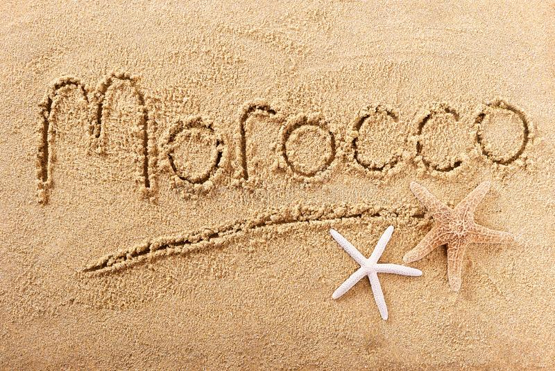 Palavra da praia de Marrocos que escreve o conceito do curso da mensagem fotografia de stock