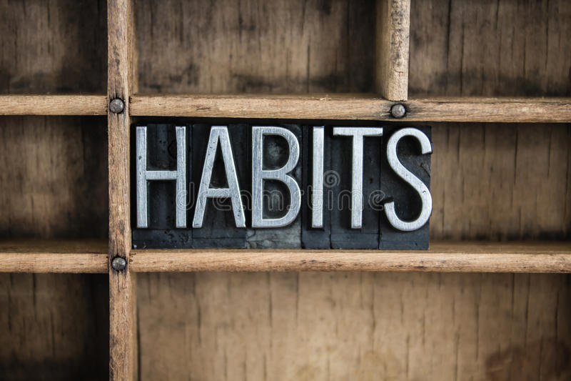 Palavra da tipografia do metal do conceito dos hábitos na gaveta fotos de stock