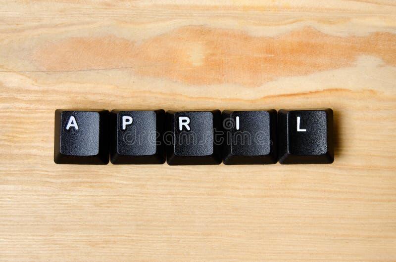 Palavra de abril fotos de stock
