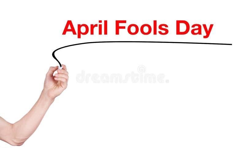 A palavra do dia dos enganados escreve no fundo branco fotografia de stock