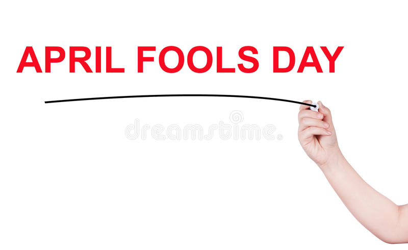 A palavra do dia dos enganados escreve no fundo branco imagem de stock royalty free
