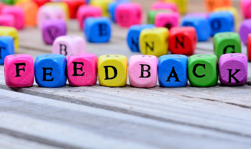 Palavra do feedback na tabela foto de stock royalty free