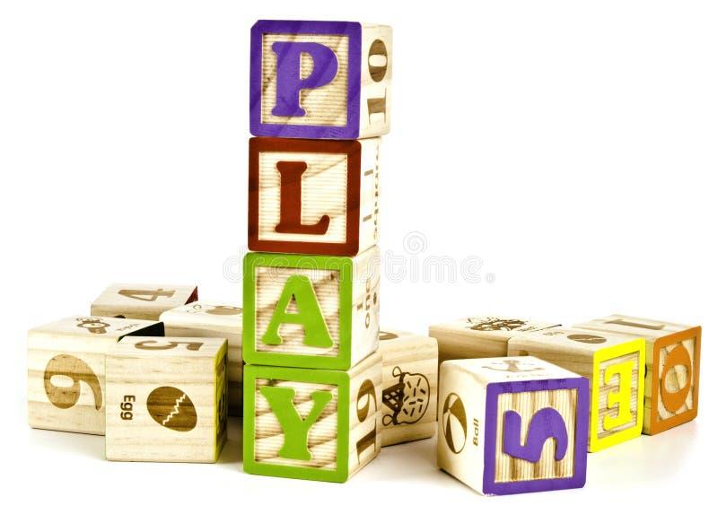 Palavra do jogo em letras de bloco de madeira imagens de stock