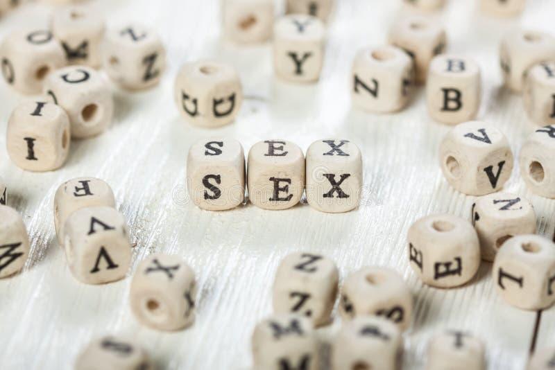 Palavra do sexo escrita no bloco de madeira foto de stock royalty free