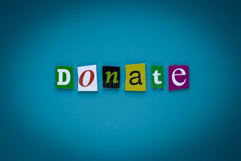 A palavra doa de letras cortadas no fundo azul Conceito da doação Título - doe Uma palavra que escreve o texto - doe Bandeira com imagens de stock