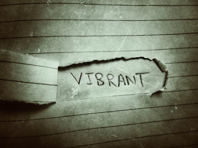 a palavra em inglês vibrant no fundo escuro e o papel de página cortado fotos de stock