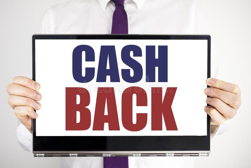 Palavra, escrevendo a dinheiro Cashback traseiro O conceito do negócio para a segurança do dinheiro escrita no portátil da tabule fotos de stock