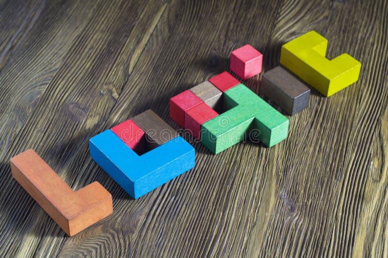 A palavra na lógica de blocos de madeira multicoloured imagem de stock